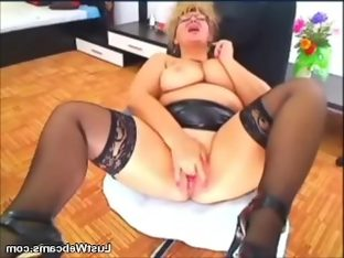 Busty mature in leather skirt fingering her..